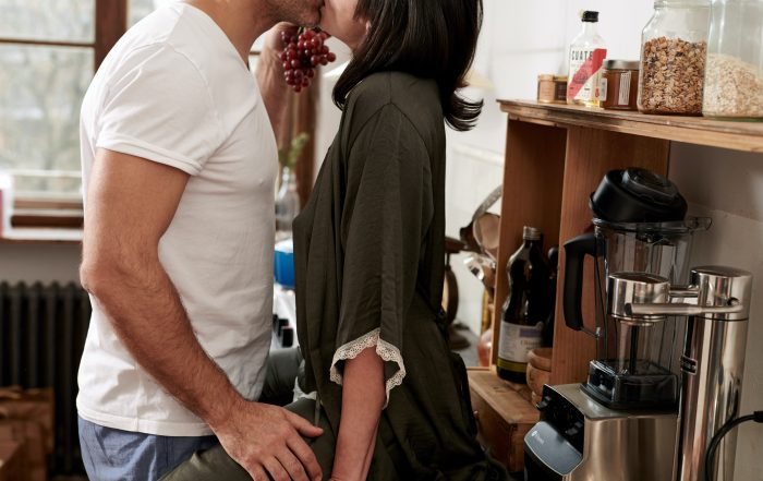 Man and women close and intimate on counter top
