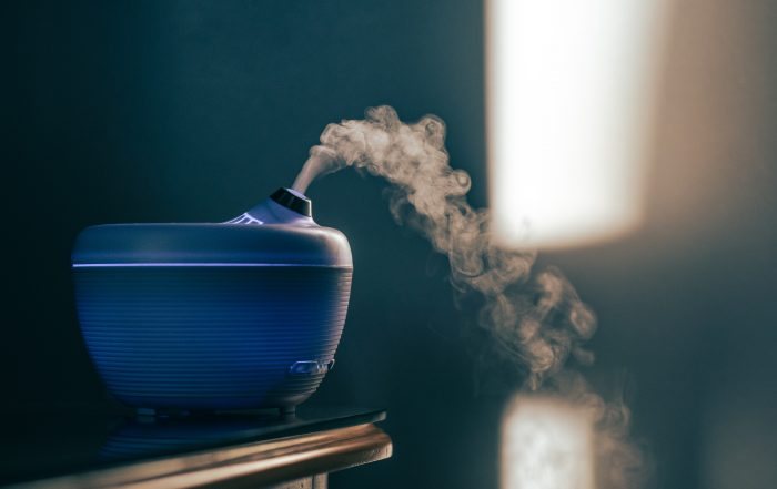 Blue essential oil diffuser emitting scent