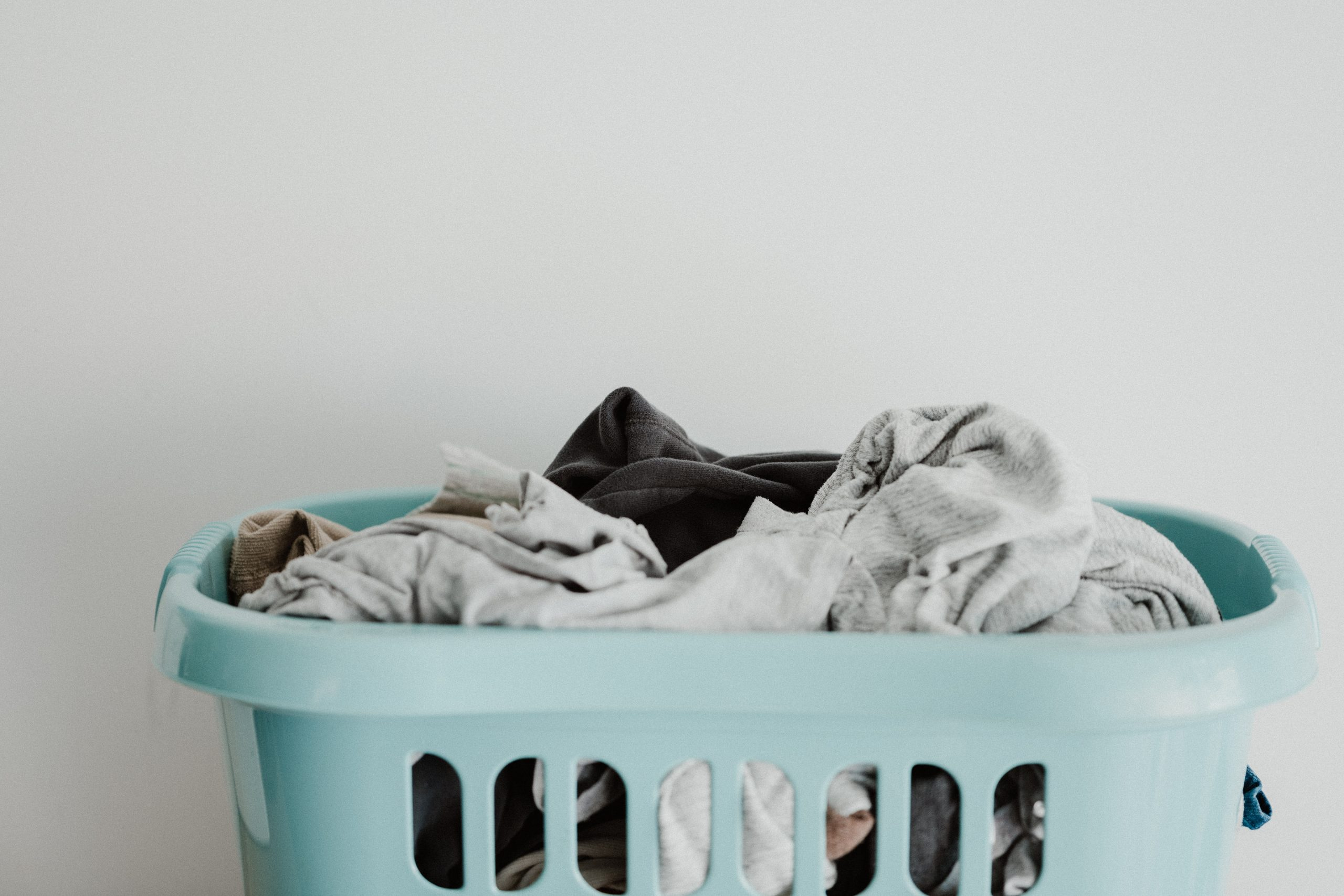 Laundry in light blue basket